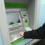 Image of person at ATM