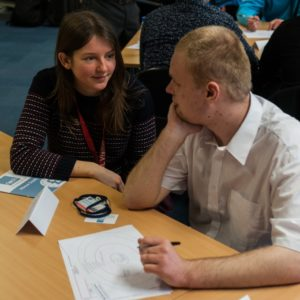 Financial Advocate Maddy working with person at workshop